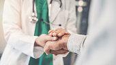 Health worker holding patient's hand