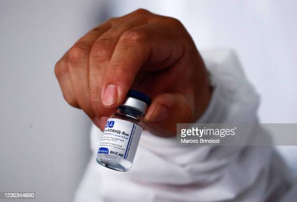 Health worker holds the first dose of 'Gam-COVID-Vac' also known as Sputnik V vaccine against coronavirus as she prepares to administer it at Isidoro...