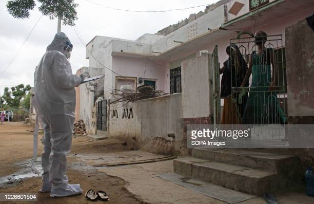 Health worker in personal protective equipment collects the details of the people, to be tested for the novel corona virus disease , during a...