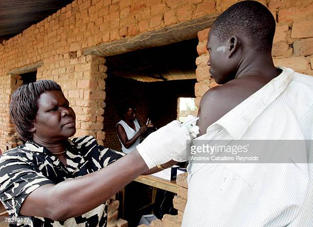 A health worker injects a man with a meningitis vaccine at a field post February 14 2007 in Aura Uganda MSF conducted a massive vaccination campaign...