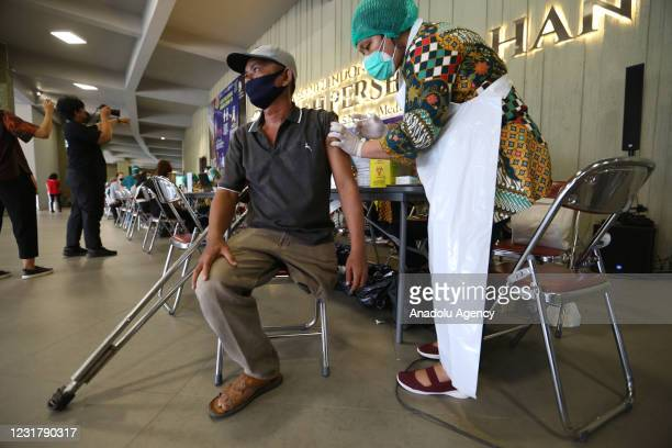 Health worker injects the Covid-19 vaccine into persons with disabilities in Medan, North Sumatra, Indonesia on March 18, 2021. As many as 500 people...