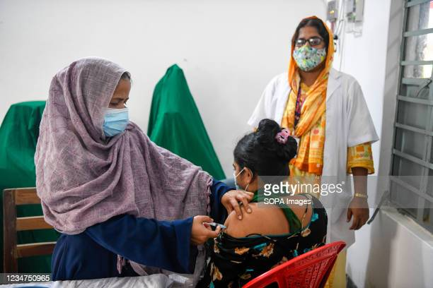 Health worker inoculates a sex worker with the dose of Sinopharm vaccine against the Covid-19 coronavirus during a special vaccination drive at...