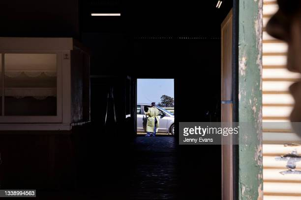 Health worker is seen at a pop up COVID-19 clinic at Narromine Racecourse on September 08, 2021 in Narromine, Australia. New freedoms have been...