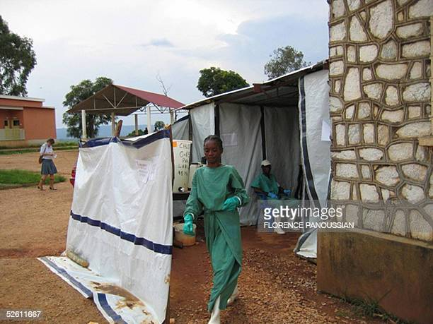 A health worker leaves an isolated area 10 April 2005 in Uige about 300km north of the capital Luanda in a makeshit tent where Marburgvirus suffering...