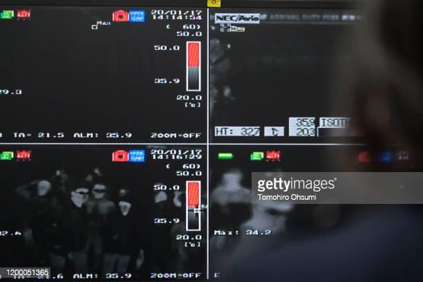 Health worker monitors a thermal scanner as passengers arrive at Narita airport on January 17, 2020 in Narita, Japan. Japan's Ministry of Health,...