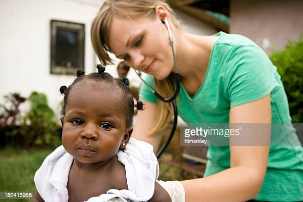health worker - little girls giving head stock photos and pictures