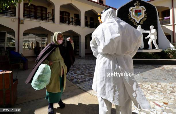 Health worker prepares to test an elderly woman for COVID-19 at the San Jose nursing home in Cochabamba, Bolivia, on July 17, 2020. - Ten elderly...