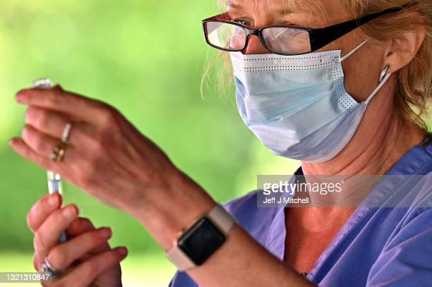Health worker prepares to vaccinate members of the public on the South Side of the city who are over forty on June 02, 2021 in Glasgow, Scotland....