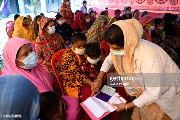 Health worker seen registering sex workers against the Covid-19 coronavirus at special vaccination drive held in Daulatdia outskirt of Dhaka.