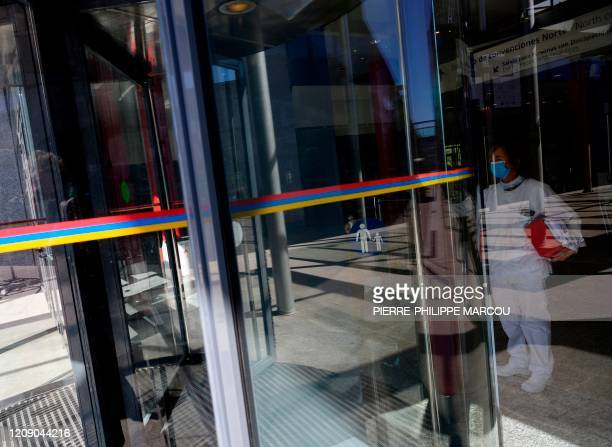 A health worker stands at the entrance of the Ifema convention and exhibition centre in Madrid on April 03 2020 where a temporary hospital for...