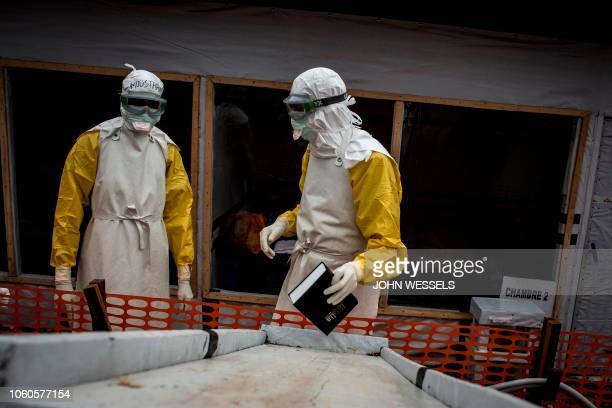 A health worker takes a bible to an Ebola patient inside the red zone of a MSF supported Ebola Treatment Centre November 3 2018 in Butembo Democratic...