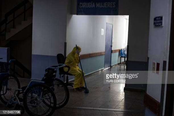 Health worker takes a break after working in the intensive care unit of the San Rafael Hospital where patients infected with the novel coronavirus,...