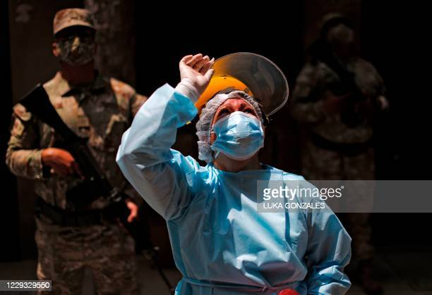 Health worker takes part in a preventive vaccination campaign against diphtheria in Lima, on October 28 after a case was detected at a popular...