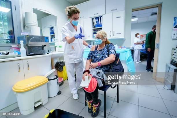 Health worker vaccinates a homeless woman at the Centro de Acogida Municipal Para Personas Sin Hogar San Isidro, on 20 May, 2021 in Madrid, Spain....