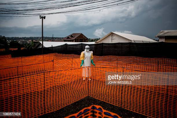 TOPSHOT A health worker waits to handle a new unconfirmed Ebola patient at a newly build MSF supported Ebola treatment centre on November 7 2018 in...