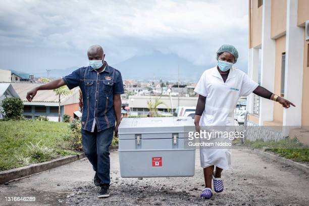 Health worker walks through the courtyard during the COVID-19 vaccination campaign on May 05, 2021 in Goma, Democratic Republic of Congo. The central...