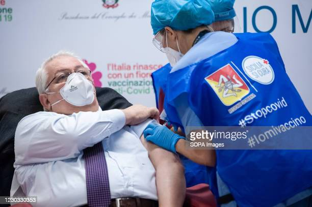 Health worker wearing a face mask gets vaccinated at Civico Hospital. Civico Hospital in Palermo Kicks-off Sicilys Covid-19 Vaccination Campaign....