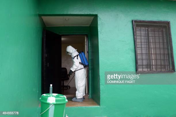 A health worker wearing a protective suit disinfects a house during an ebola prevention drill at the port in Monrovia on August 29 2014 The World...