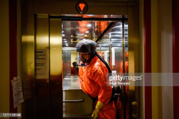 Health worker wears a protective suit and gloves as he moves the body of a deceased COVID-19 patient in a metal coffin at the ICU of Krakow...