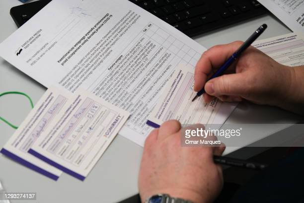 Health worker writes vaccination certificates for the first the health workers taking Pfizer BioNTech Covid-19 vaccine at Krakow University Hospital...