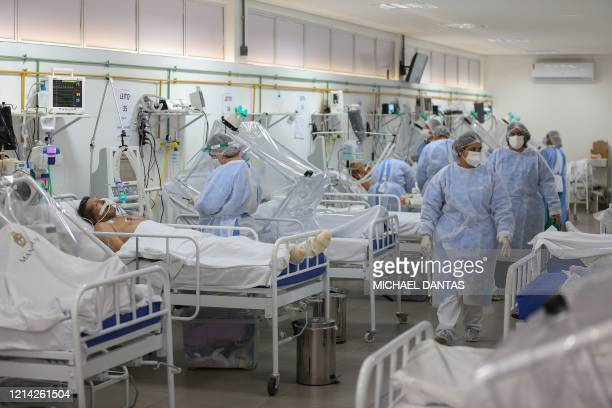 Health workers and patients remain in the Intensive Care Unit for COVID-19 of the Gilberto Novaes Hospital in Manaus, Brazil, on May 20, 2020. -...
