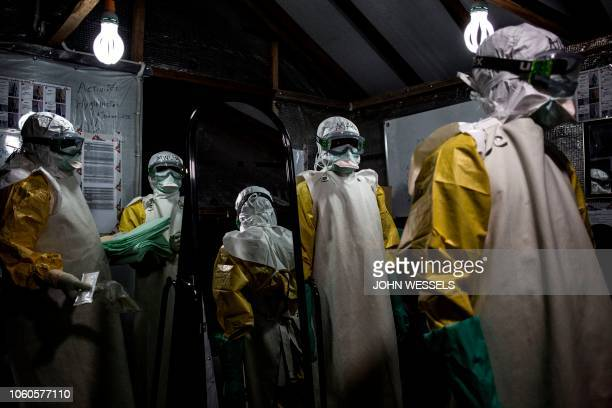 Health workers are seen with their personal protective equipment before entering the red zone of a MSF supported Ebola Treatment Centre where they...