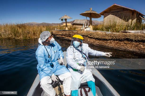 Health workers are transported to the Uros islands to inoculate citizens with a dose of the Sinopharm vaccine against COVID-19, in the Titicaca lake...