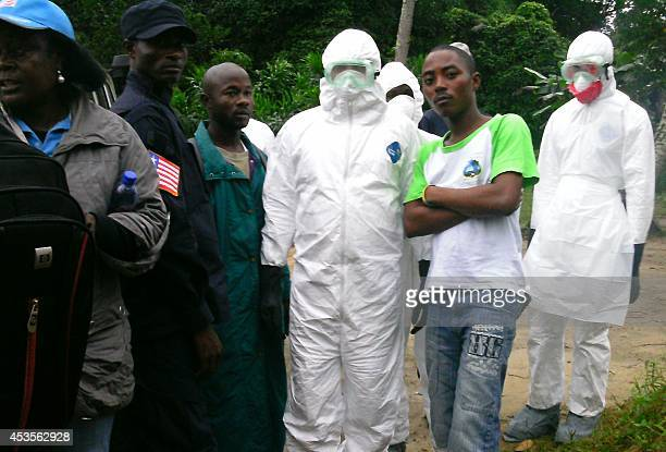 Health workers arrive to bury the body of Seidia Passawee Sherrif who succumbed to the deadly Ebola virus along with her husband Abdulah and daughter...