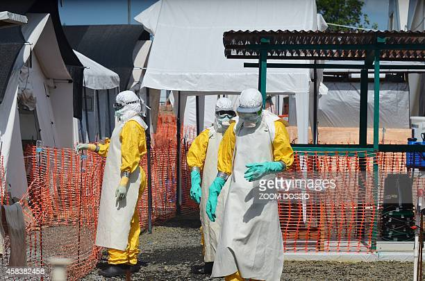 Health workers at a clinic run by the nongovernmental organization Medecin Sans Frontieres in Monrovia who have not contracted the Ebola virus wear...