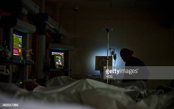 Health workers care for patients at the neurological Intensive Care Unit of The First Affiliated Hospital of Zhengzhou University on February 7, 2015...