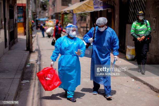 Health workers carry out a preventive vaccination campaign against diphtheria in Lima, on October 28 after a case was detected at a popular district....