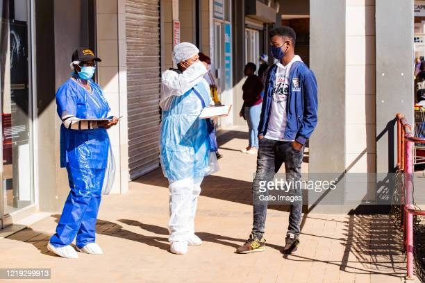 Health workers conduct COVID-19 mass screening at Shoprite Corner in Tsakane on June 10, 2020 in Ekurhuleni, South Africa. It is reported that the...