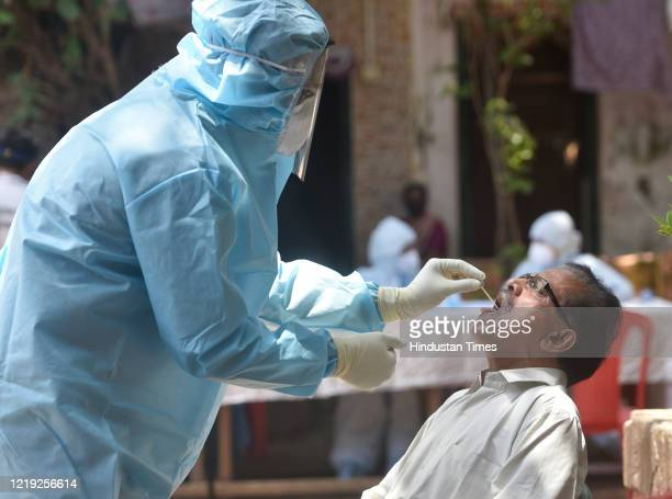 Health workers conducting COVID-19 coronavirus testing drive at Dharavi Slum, during a government-imposed nationwide lockdown as a preventive measure...
