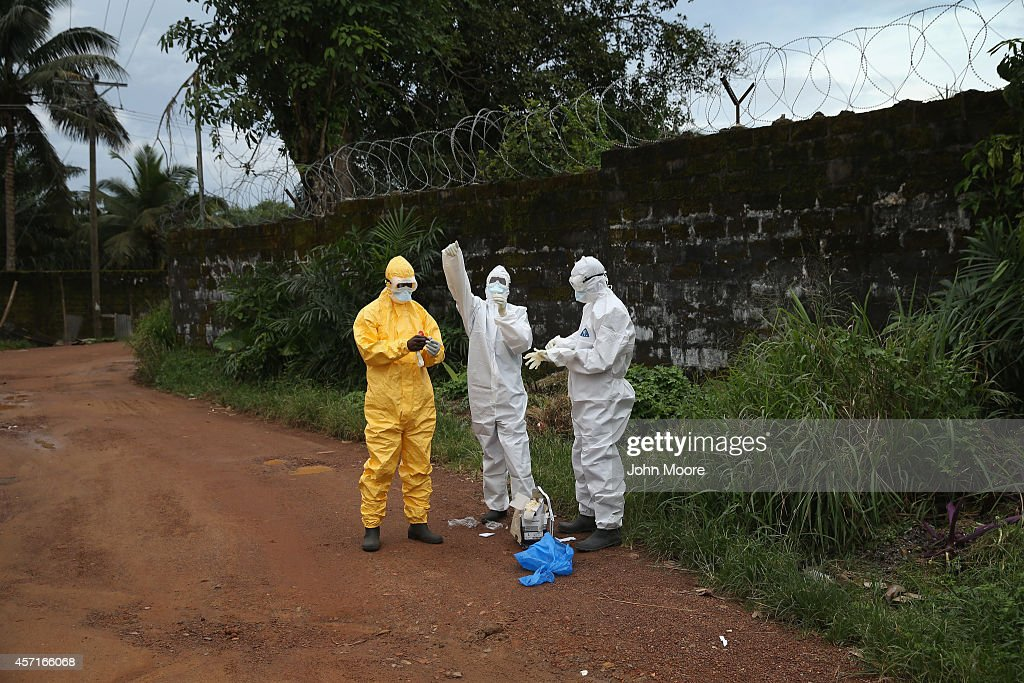Health workers dress in protective clothing before taking the body of an Ebola victim from the Island Clinic Ebola treatment center on October 13, 2014 in Monrovia, Liberia. A planned strike at Ebola treatment centers was averted as most nurses and health care workers reported for work, many saying they could not in good conscience leave their patients unattended. Health workers have been asking for increased hazard pay. They are one of the most high-risk groups of Ebola infection, as nearly 100 of them have died in Liberia alone.