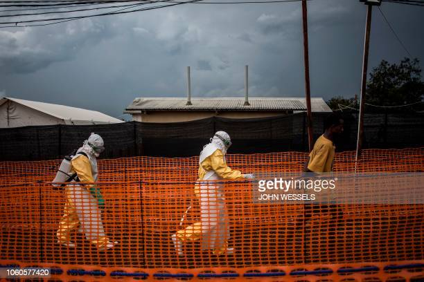 Health workers escort a new unconfirmed Ebola patient at a newly build MSF supported Ebola treatment centre on November 7 2018 in Bunia Democratic...