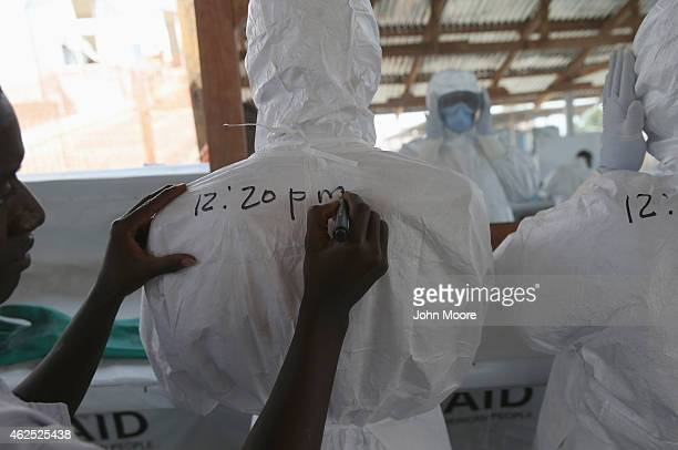 Health workers for the International Organization for Migration prepare to enter the highrisk section of the Ebola Treatment Unit on January 29 2015...