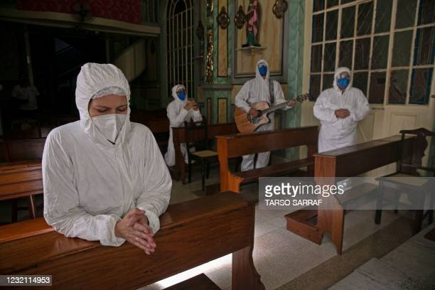 Health workers from the Portuguese charity hospital in Belem, state of Para, Brazil, get ready to play music and pray for COVID-19 patients at a...