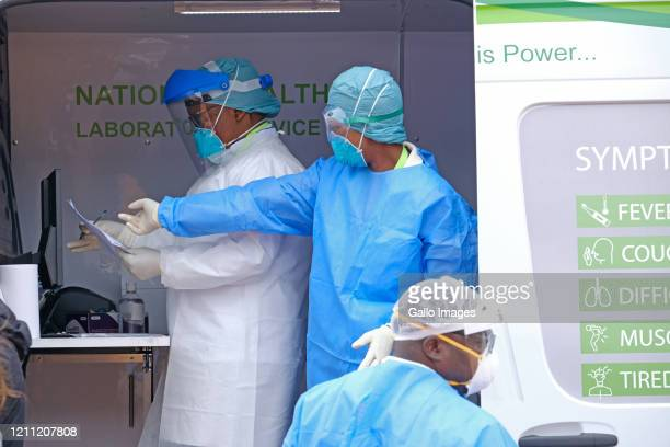 Health workers in a NHLS Mobile Testing Lab during intensified testing and screening on Freedom Dayon April 27, 2020 in Alexandra, South Africa. It...