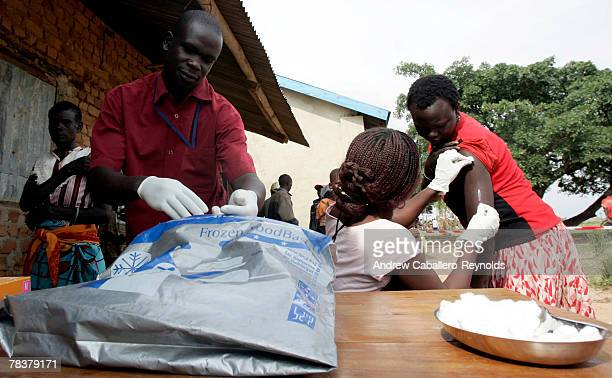 Health workers inject people with a meningitis vaccine at a field post February 13 2007 in Aura Uganda MSF conducted a massive vaccination campaign...