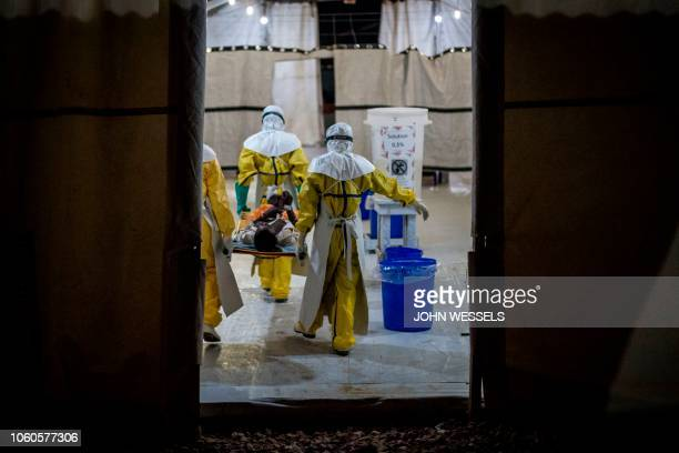 Health workers move an Ebola patient inside a MSF supported Ebola Treatment Centre on November 3 2018 in Butembo Democratic Republic of the Congo The...
