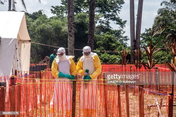 Health workers operate within an Ebola safety zone in the Health Center in Iyonda near Mbandaka on June 1 2018 The UN health agency and DRC...