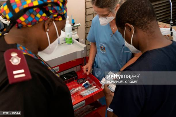 Health workers prepare needles to administer the Johnson and Johnson vaccine at the Chris Hani Baragwanath Hospital in Soweto on February 17, 2021.