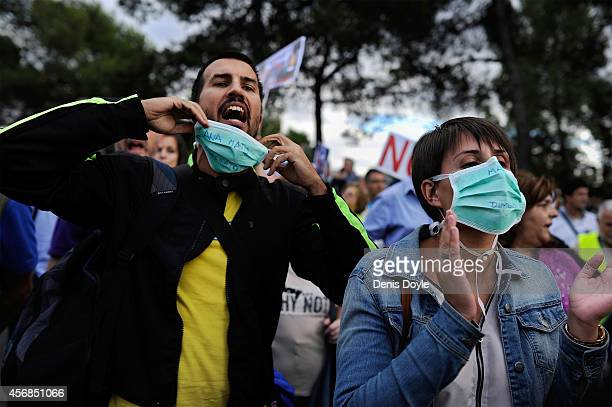 Health workers protest about the government's handling of the Ebola infection outside the Carlos III hospital where a nurse is being treated after...