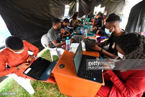 Health workers study with laptops results of tests to dictate levels of infections at Surveillance and Epediomology section at the Infectious Disease...