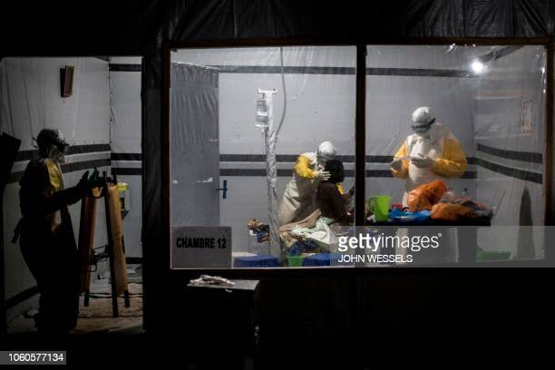 TOPSHOT Health workers treat an unconfirmed Ebola patient inside a MSF supported Ebola Treatment Centre on November 3 2018 in Butembo Democratic...