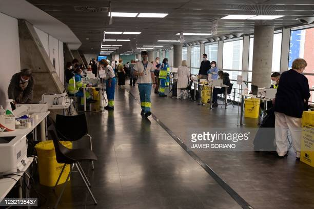 Health workers vaccinate people against Covid-19 during a mass vaccination campaign for people over 60 with the AstraZeneca vaccine at the WiZink...
