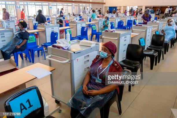 Health workers wait to administer the Johnson and Johnson vaccine at the Chris Hani Baragwanath Hospital in Soweto on February 17, 2021.