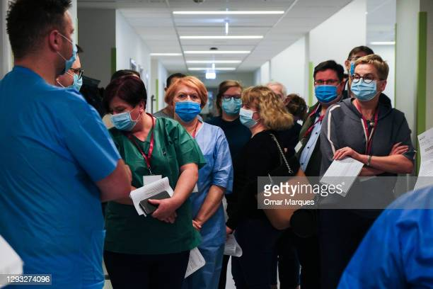 Health workers wait to be given the first jab of Pfizer BioNTech Covid-19 at Krakow University Hospital on December 27, 2020 in Krakow, Poland. On...
