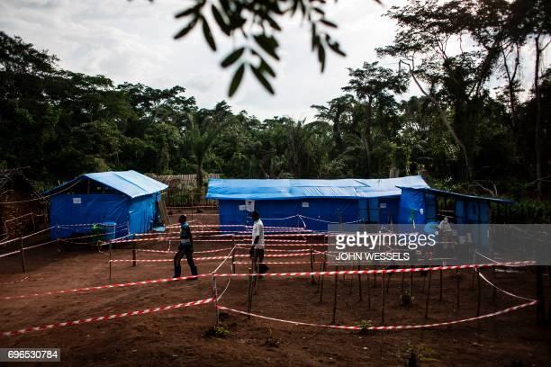 Health workers walk at an Ebola quarantine unit on June 13 2017 in Muma after a case of Ebola was confirmed in the village Two cases of the Ebola...