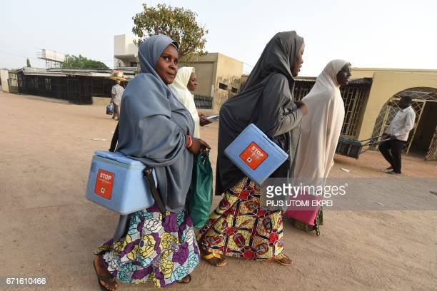 Health workers walk from house to house in search of children to immunise during vaccination campaign against polio at Hotoro-Kudu, Nassarawa...